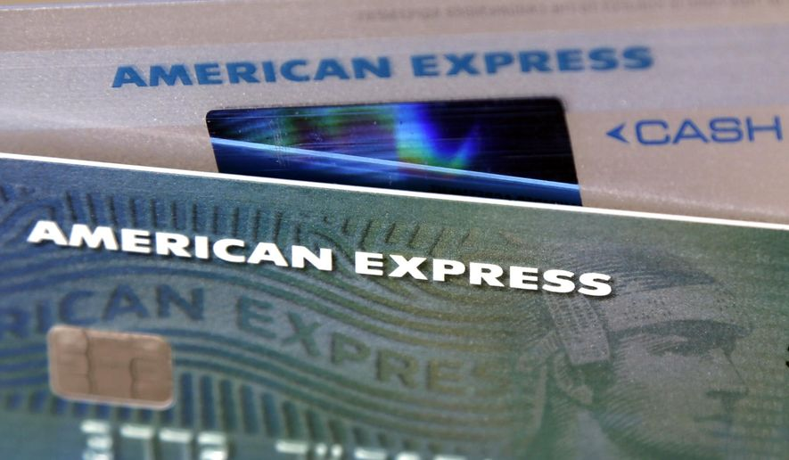 FILE - This Monday, July 18, 2016, file photo shows American Express credit cards, in North Andover, Mass. American Express Co. reports financial results, Wednesday, Oct. 18, 2017. (AP Photo/Elise Amendola, File)