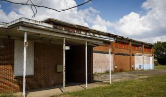 A Monday, Oct. 2, 2017photo shows the former all-black school in the Joppa neighborhood, in Dallas. The property is now owned by Habitat for Humanity, which is trying to determine what to to do with it.  (Smiley N. Pool/The Dallas Morning News via AP)