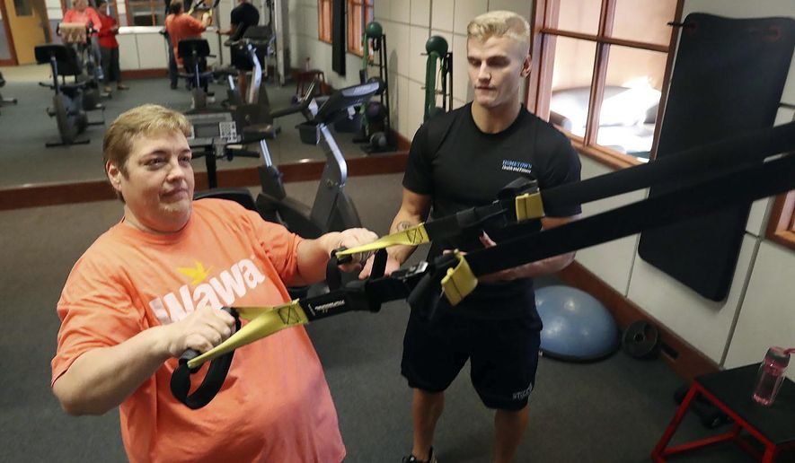 This photo taken Oct. 3, 2017, shows Cheryl Farley, of Mays Landing, NJ, who has always struggled with her weight, until she found a program and trainer Joseph LaCerra that helped her lose 100+ lbs and get off 11 different medications for things like heart issues, pre-diabetes, hypertension at Hometown Health and Fitness in Mays Landing, NJ. (Edward Lea/The Press of Atlantic City via AP)