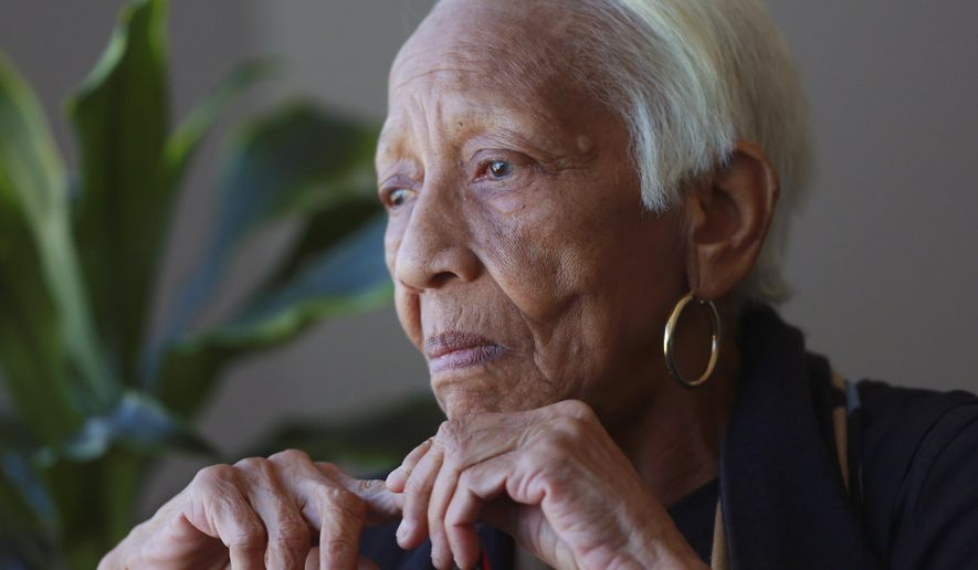 FILE - In this Jan. 11, 2016, file photo, Doris Payne speaks during an interview in Atlanta. The notorious jewel thief arrested at a Walmart in Georgia got no jail time during her latest court appearance. She was arrested July 17 for a misdemeanor shoplifting charge after a Walmart employee said she tried to leave the suburban Atlanta store with items she hadn't paid for. (AP Photo/John Bazemore, File)