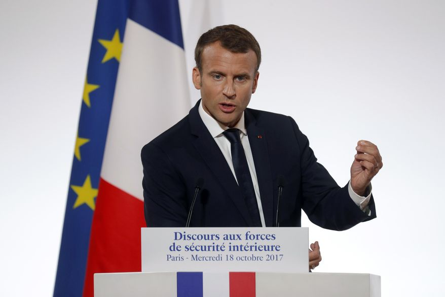 """French President Emmanuel Macron delivers a speech on security to representatives of French national police, gendarmes and """"Sentinelle"""" security plan soldiers at the Elysee Palace in Paris, France, Wednesday, Oct. 18, 2017. Macron is expected to launch a new police unit that would focus on daily life especially in working-class neighborhoods. (Philippe Wojazer/Pool Photo via AP)"""