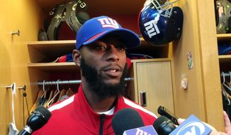 New York Giants cornerback Dominique Rodgers-Cromartie speaks with reporters in the locker room at the NFL football team's training facility, Wednesday, Oct. 18, 2017, in East Rutherford, N.J. (AP Photo/Tom Canavan)