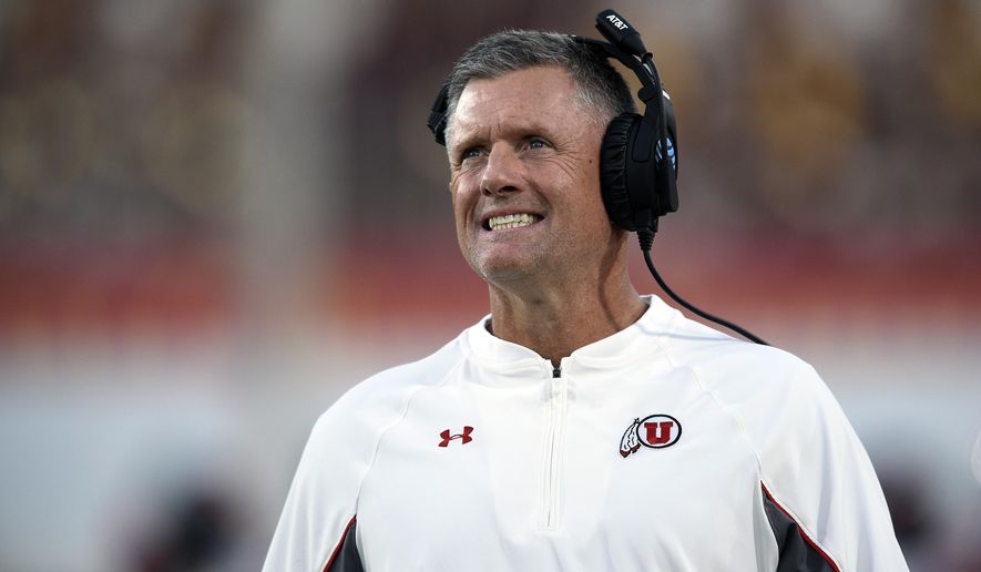"""FILE - In this Saturday, Oct. 14, 2017 file photo, Utah head coach Kyle Whittingham watches from the sideline during the first half of an NCAA college football game against Southern California in Los Angeles. Faced with the decision to kick an extra point to tie or go for two and the lead late in games last weekend, two college football coaches did not hesitate to basically put it all one play instead of trying to get to overtime. """"It would have been a gamble to kick the extra point,"""" said Utah coach Kyle Whittingham, whose team failed to convert with 42 seconds left in the fourth quarter and lost 28-27 at Southern California last Saturday night. (AP Photo/Kelvin Kuo, File)"""