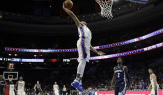 Philadelphia 76ers' Markelle Fultz goes up for a dunk during the second half of a preseason NBA basketball game against the Memphis Grizzlies, Wednesday, Oct. 4, 2017, in Philadelphia. (AP Photo/Matt Slocum)