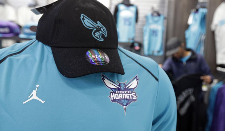 "The Michael Jordan ""Jumpman"" logo is shown on merchandise as a customer shops at the Charlotte Hornets' NBA basketball fan store in Charlotte, N.C., Tuesday, Oct. 17, 2017. The NBA's new uniform contract with Nike could be a financial coup for Hornets owner Michael Jordan. Sports' greatest pitchman will be reaping the benefits of the Hornets being the only NBA team to wear the famous Jordan Brand ""Jumpman"" logo on their jerseys this season. (AP Photo/Chuck Burton)"