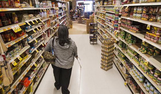 In a Wednesday, Sep. 20, 2017 photo, Carmen De Molina, who became blind five years ago from diabetes, works on walking with her cane through Ridley's while grocery shopping with the Wyoming Independent Living class in Casper, Wyo. The class allows visually impaired individuals and people with other disabilities to practice skills which they can use to be more independent.  (Josh Galemore/The Casper Star-Tribune via AP)