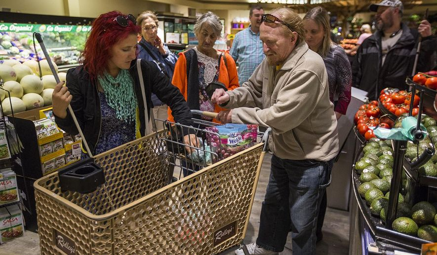 In a Wednesday, Sep. 20, 2017 photo, the Wyoming Independent Living class shops for groceries at Ridley's in Casper, Wyo. The class allows visually impaired individuals and people with other disabilities to practice skills which they can use to be more independent.  (Josh Galemore/The Casper Star-Tribune via AP)