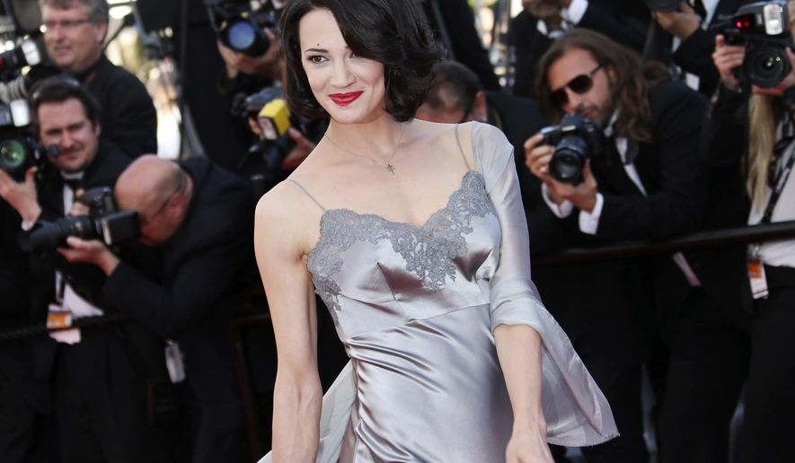 "FILE - In this May 26, 2013 file photo, actress Asia Argento arrives for the awards ceremony of the 66th international film festival, in Cannes, southern France. Italian Actress Asia Argento declares Harvey Weinstein the ""biggest serial predator in the history,"" and says she has been ""doubly crucified"", first by the sexual violence and second by the media in TV interview. She says the abuse when she was 21 ""smashed all my dreams and changed my perception of myself."" (Photo by Joel Ryan/Invision/AP, File)"