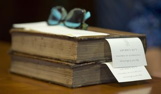 This Friday, June 30, 2017 shows a rare book at the University of Virginia School of Law rare books collection Charlottesville, Va. Nearly 200 years ago, Thomas Jefferson came up with a legal reading list for lawyers. Now, the University of Virginia is putting those books online. (AP Photo/Steve Helber)