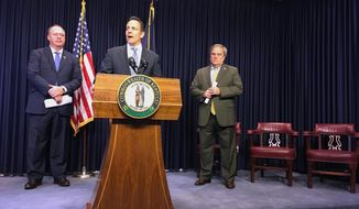Kentucky Republican Gov. Matt Bevin answering questions about a plan to make changes to the state's struggling public pension system on Wednesday, Oct. 18, 2017, in Frankfort, Ky. Republican state House Speaker Jeff Hoover, left, and Republican state Senate President Robert Stivers, right, crafted the proposal with Bevin over many months of negotiations. (AP Photo/Adam Beam)
