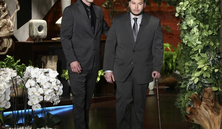"""In this Oct. 17, 2017, photo released by Warner Bros., Stephen Schuck, left, and Jesus Campos appear at a taping of """"The Ellen DeGeneres Show"""" at the Warner Bros. lot in Burbank, Calif. Schuck, a building engineer, and Campos, a security guard, were working at the Mandalay Bay Resort and Casino the night of the mass shooting on Oct. 1. Campos was shot by gunman Stephen Paddock. The show airs on Wednesday. (Photo by Michael Rozman/Warner Bros.)"""