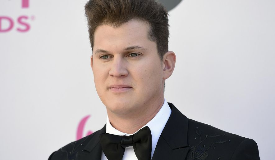 FILE - In this April 2, 2017 file photo, Jon Pardi arrives at the 52nd annual Academy of Country Music Awards at the T-Mobile Arena in Las Vegas. While other country singers have been experimenting with hip hop, R&B and EDM trends,  Pardi is doubling down on the fiddles and the steel guitar. The California native is nominated for new artist of the year and single of the year at the Country Music Association Awards in November. (Photo by Jordan Strauss/Invision/AP, File)