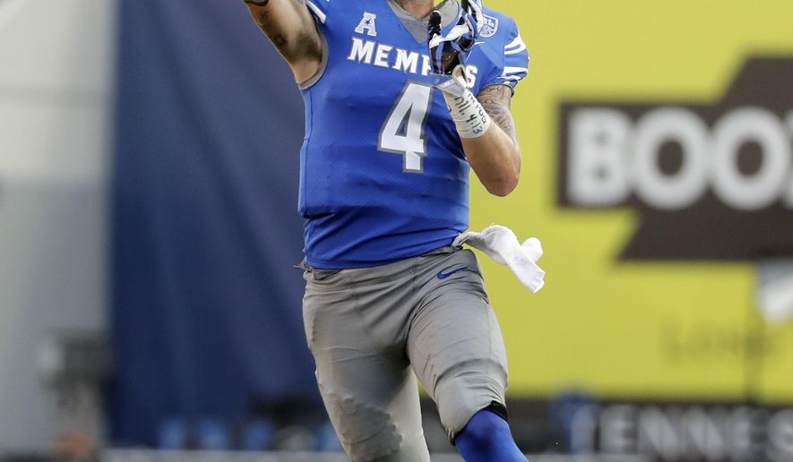 Memphis quarterback Riley Ferguson (4) passes against Navy in the second half of an NCAA college football game Saturday, Oct. 14, 2017, in Memphis, Tenn. Memphis upset Navy 30-27. (AP Photo/Mark Humphrey)