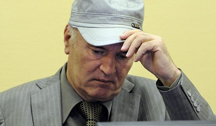 FILE- In this Friday, June 3, 2011, image former Bosnian Serb Gen. Ratko Mladic removes his hat in the court room during his initial appearance at the U.N.'s Yugoslav war crimes tribunal in The Hague, Netherlands. A United Nations war crimes tribunal will deliver its verdicts on Nov. 22, 2017, in the long-running trial of former Bosnian Serb military chief Mladic. Mladic was tried on 11 counts including genocide, murder and terror for allegedly overseeing atrocities by Serb forces in Bosnian's 1992-95 war that left 100,000 dead. (AP Photo/Martin Meissner, Pool)