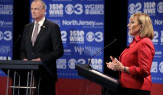 Republican nominee Lt. Gov. Kim Guadagno, right, answers a question during a gubernatorial debate against Democratic nominee Phil Murphy at William Paterson University, Wednesday, Oct. 18, 2017, in Wayne, N.J. (AP Photo/Julio Cortez, pool)