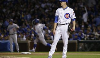 Los Angeles Dodgers' Chris Taylor (3) runs bases after hitting a home run as Chicago Cubs starting pitcher Kyle Hendricks reacts during the third inning of Game 3 of baseball's National League Championship Series, Tuesday, Oct. 17, 2017, in Chicago. (AP Photo/Nam Y. Huh)