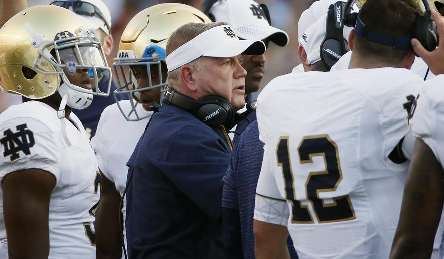 FILE - In this Sept. 16, 2017, file photo, Notre Dame head coach Brian Kelly stands with his team during the second half of an NCAA college football game against Boston College in Boston. No. 13 Notre Dame is 5-1 halfway through a crucial year for coach Kelley. Players say Kelley and the rest of the coaching staff became much more involved after last year's 4-8 debacle. (AP Photo/Michael Dwyer, File)
