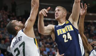 Denver Nuggets center Mason Plumlee (24) shoots as Utah Jazz center Rudy Gobert (27) defends during the first half of an NBA basketball game Wednesday, Oct. 18, 2017, in Salt Lake City. (AP Photo/Rick Bowmer)