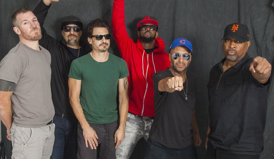 In this Sept. 12, 2017 photo, Tim Commerford, from left, B-Real, Brad Wilk, DJ Lord, Tom Morello and Chuck D of Prophets of Rage pose for a portrait in New York to promote their self-titled debut album. (Photo by Andy Kropa/Invision/AP)