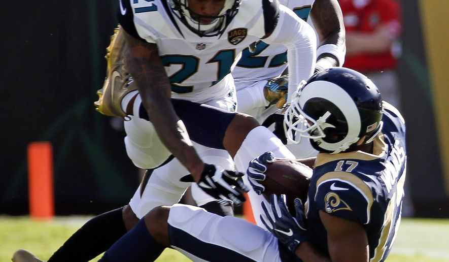 Jacksonville Jaguars cornerback A.J. Bouye (21) stops Los Angeles Rams wide receiver Robert Woods (17) after a reception during the first half of an NFL football game, Sunday, Oct. 15, 2017, in Jacksonville, Fla. (AP Photo/Stephen B. Morton)