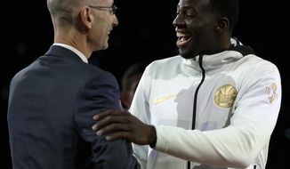 NBA commissioner Adam Silver, left, congratulates Golden State Warriors' Draymond Green during a ring ceremony prior to the basketball game against the Houston Rockets Tuesday, Oct. 17, 2017, in Oakland, Calif. (AP Photo/Ben Margot)