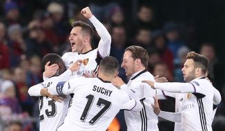 Basel's Taulant Xhaka celebrates with teammates after scoring his side's first goal during the Champions League Group A soccer match between CSKA Moscow and Basel in Moscow, Russia, Wednesday, Oct. 18, 2017. (AP Photo/Ivan Sekretarev)