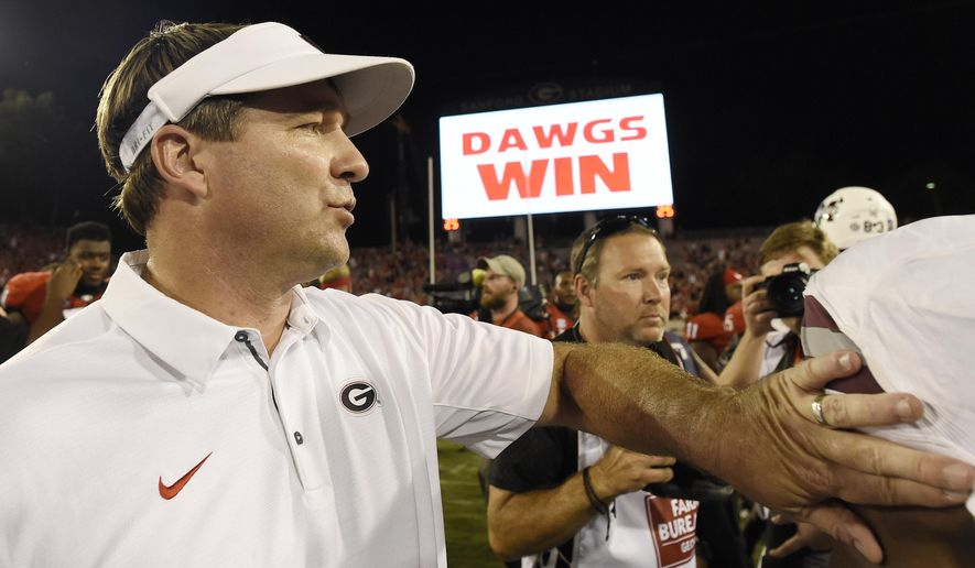 FILE - In this Sept. 23, 2017, file photo, Georgia head coach Kirby Smart walks the turf after an NCAA college football game against Mississippi State in Athens, Ga. The Southeastern Conference has produced upsets, letdowns, blowouts and frantic finishes, and it's only the midway point of the season.  (AP Photo/Mike Stewart, File)