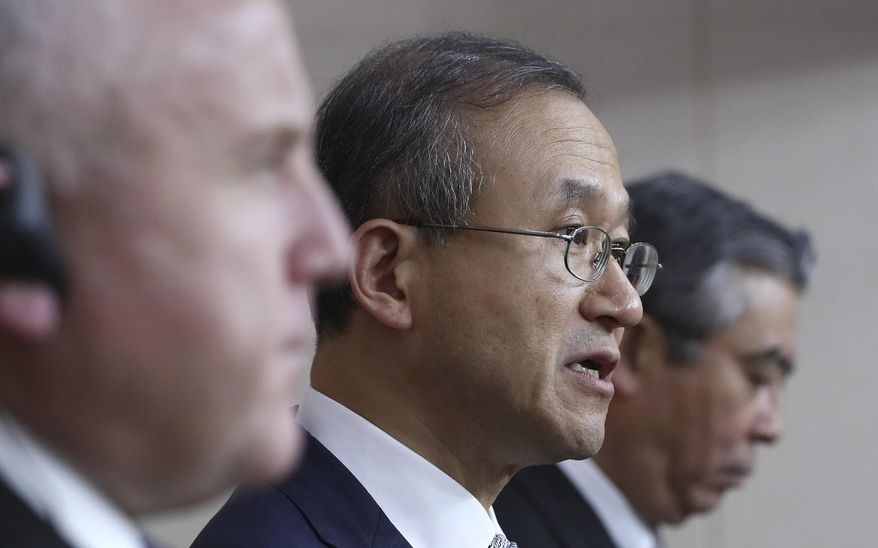 South Korean Vice Foreign Minister Lim Sung-nam, center, answers reporter's question as U.S. Deputy Secretary of State John Sullivan, left, and Japanese Deputy Foreign Minister Shinsuke Sugiyama listen during a press conference following their meeting at the Foreign Ministry in Seoul, South Korea, Wednesday, Oct. 18, 2017. (AP Photo/Lee Jin-man, Pool)