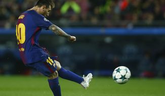 Barcelona's Lionel Messi kicks the ball to score during the group D Champions League soccer match between FC Barcelona and Olympiakos at the Camp Nou stadium in Barcelona, Spain, Wednesday, Oct. 18, 2017. (AP Photo/Manu Fernandez)
