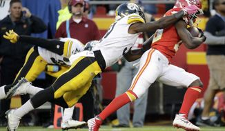 Kansas City Chiefs wide receiver De'Anthony Thomas (13) breaks a tackle by Pittsburgh Steelers cornerback Mike Hilton (31) to run for a touchdown during the second half of an NFL football game in Kansas City, Mo., Sunday, Oct. 15, 2017. (AP Photo/Charlie Riedel)