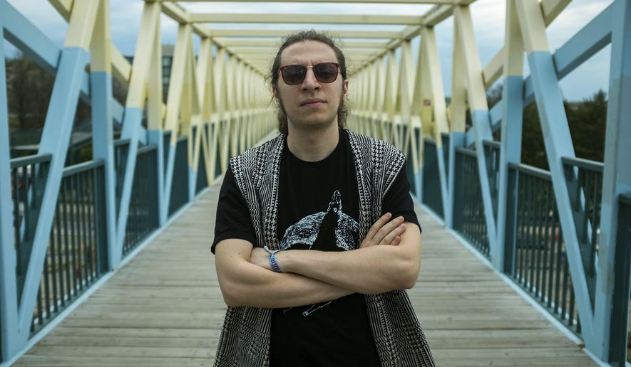 This image released by Andrew Cagle shows electronic artist and musician Samer Saem Eldahr, better known as Hello Psychaleppo, in Minneapolis. Eldahr fled the Syrian city of Aleppo five years ago and has been rebuilding his life and art as a permanent U.S. resident. (Andrew Cagle via AP)