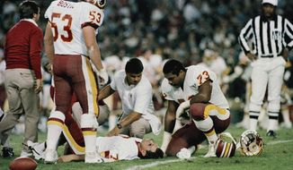 FILE - In this Nov. 18, 1985, file photo, Washington Redskins quarterback Joe Theismann lies on the ground after he injured his right leg during the first half of an NFL game against the New York Giants at RFK Stadium in Washington. Former NFL quarterback Joe Theismann saw the video of Boston Celtics forward Gordon Hayward's broken left ankle and immediately felt a kind of empathy few could.  (AP Photo/J. Scott Applewhite, File) **FILE**