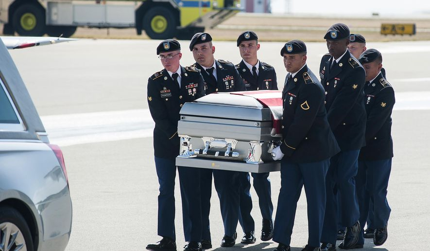 FILE - In this Oct. 13, 2017, photo, soldiers carry the casket of Spc. Alex Missildine from the tarmac at Tyler Pounds Regional Airport in Tyler, Texas. (Cory McCoy/Tyler Morning Telegraph via AP)