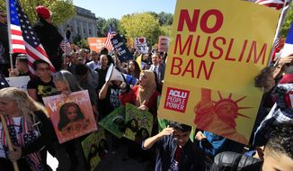 "Muslim and civil rights groups and their supporters gather at a rally against what they call a ""Muslim ban"" in Washington on Oct. 18, 2017. (Associated Press) **FILE**"