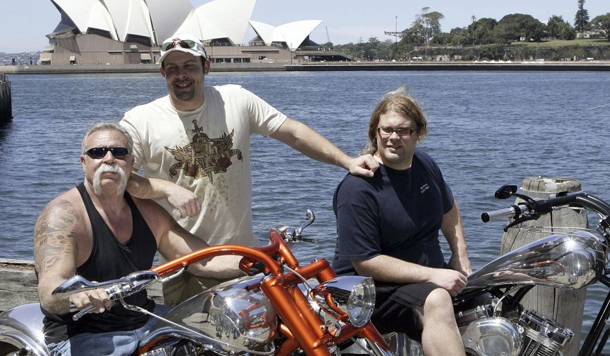 "FILE - In this Feb. 15, 2007, file photo, Paul Teutul Sr. left, and sons Paul Jr. center, and Mikey from the popular reality television show ""American Chopper"" try out an Australian made chopper during a visit to Sydney, Australia. Discovery Channel announced on Oct. 18, 2017, it will revive the series in 2018. (AP Photo/Rob Griffith, File)"