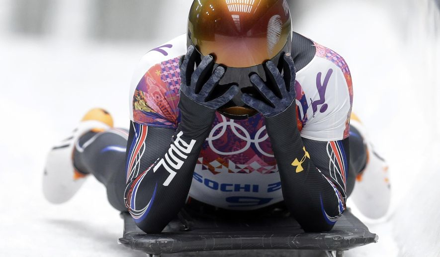 FILE - In this Feb. 15, 2014, file photo, John Daly of the United States puts his head in his hands after a bad final run that dropped him out of medal contention during the men's skeleton competition at the 2014 Winter Olympics, in Krasnaya Polyana, Russia. Daly is through the first step in his latest Olympic quest. Daly, who saw a chance at an Olympic medal go awry in his final run of the Sochi Games, was among 12 sliders announced Wednesday as members of the U.S. National Team and will start his season on the World Cup circuit.  (AP Photo/Natacha Pisarenko, File)