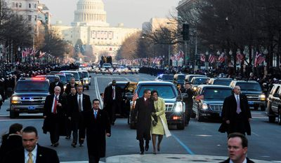 President Barack Obama and his wife Michelle walk down Pennsylvania Avenue, in the inaugural parade, to the White House after he was sworn in as the 44th President of the United States at the US Capitol in Washington, DC. Tuesday, January 20, 2009  (Mary F. Calvert / The Washington Times)