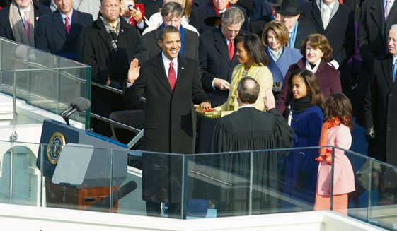 President-elect Barack Obama is sworn in as the  44th President of the United States by Chief Justice of the Supreme Court, John Roberts, at U.S. Capitol in Washington, D.C., Tuesday, January 20, 2009. (J.M. Eddins Jr. / The Washington Times)