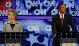 The-Democratic presidential hopefuls Sen. Hillary Rodham Clinton, D-N.Y., left, and Sen. Barack Obama, D-Ill., listen during a debate at the University of Nevada in Las Vegas, in this Thursday, Nov. 15, 2007, file photo. (AP Photo/Jae C. Hong) ** FILE **