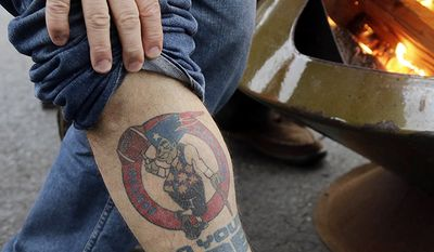 New England Patriots fan Mark Guzik, of Long Island, N.Y., displays a leg tattoo honoring his team while tailgating in the parking lot of Gillette Stadium before the AFC championship NFL football game between the Patriots and the Pittsburgh Steelers, Sunday, Jan. 22, 2017, in Foxborough, Mass. (AP Photo/Elise Amendola)