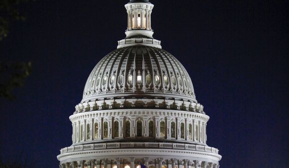 "The Capitol Dome is illuminated as the Senate works into the night on a long series of votes referred to as a ""vote-a-rama"" leading up to a vote on a GOP budget, at the Capitol in Washington, Thursday, Oct. 19, 2017. (AP Photo/J. Scott Applewhite)"