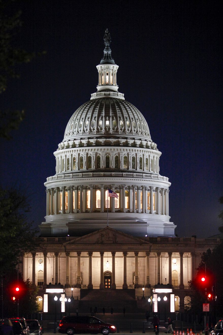 """The Capitol Dome is illuminated as the Senate works into the night on a long series of votes referred to as a """"vote-a-rama"""" leading up to a vote on a GOP budget, at the Capitol in Washington, Thursday, Oct. 19, 2017. (AP Photo/J. Scott Applewhite)"""
