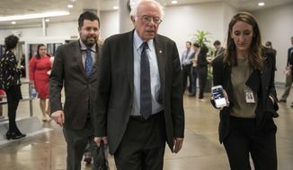 Sen. Bernie Sanders, I-Vt., the ranking member of the Senate Budget Committee, arrives for a series of votes at the Capitol in Washington, Thursday, Oct. 19, 2017. (AP Photo/J. Scott Applewhite)