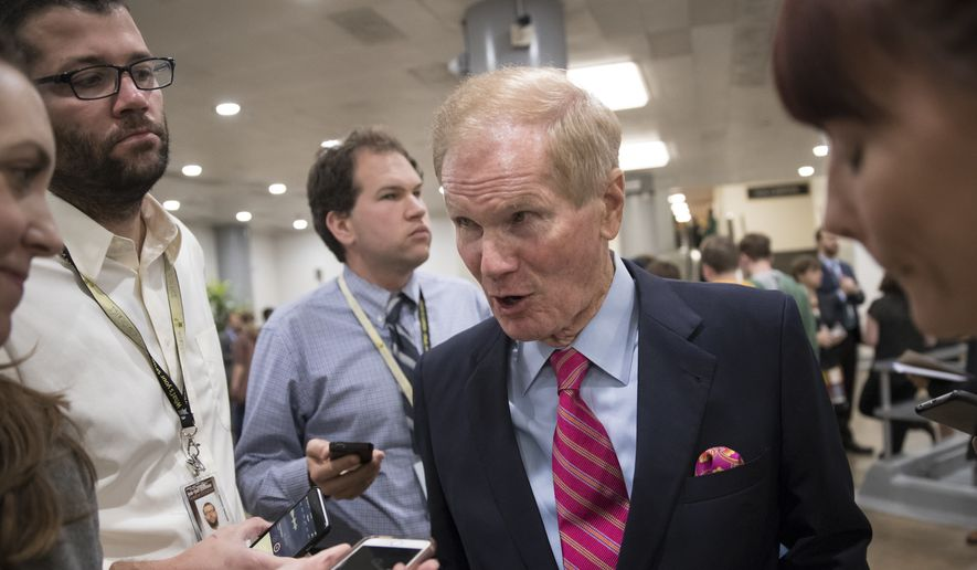Sen. Bill Nelson, D-Fla., a member of the Senate Finance Committee, speaks with reporters during a long series of votes at the Capitol in Washington, Thursday, Oct. 19, 2017. (AP Photo/J. Scott Applewhite) ** FILE **