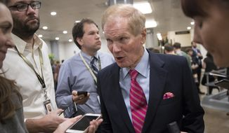 Sen. Bill Nelson, D-Fla., a member of the Senate Finance Committee, speaks with reporters during a long series of votes at the Capitol in Washington, Thursday, Oct. 19, 2017. (AP Photo/J. Scott Applewhite)