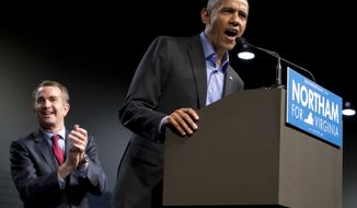 Former President Barack Obama, right, speaks as Virginia's Democratic gubernatorial candidate Lt. Gov. Ralph Northam listens during a rally in Richmond, Va., Thursday, Oct. 19, 2017. (AP Photo/Steve Helber)
