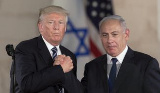 In this Tuesday, May 23, 2017, file photo, Israeli Prime Minister Benjamin Netanyahu, right, and U.S. President Donald Trump shake hands at the Israel Museum in Jerusalem. (AP Photo/Sebastian Scheiner, File)
