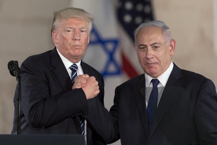 In this Tuesday, May 23, 2017, file photo, Israeli Prime Minister Benjamin Netanyahu, right, and U.S. President Donald Trump shake hands at the Israel Museum in Jerusalem. (AP Photo/Sebastian Scheiner, File)