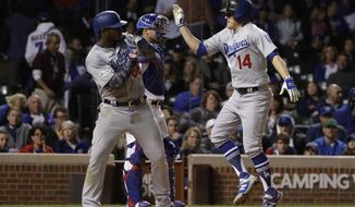Los Angeles Dodgers' Enrique Hernandez (14) celebrates with Yasiel Puig (66) after hitting a home run during the ninth inning of Game 5 of baseball's National League Championship Series against the Chicago Cubs, Thursday, Oct. 19, 2017, in Chicago. (AP Photo/Matt Slocum)