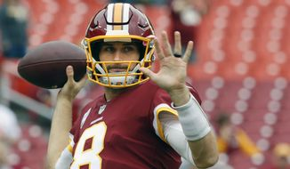 FILE - In this Sunday, Oct. 15, 2017 file photo, Washington Redskins quarterback Kirk Cousins (8) warms up before an NFL football game against the San Francisco 49ers in Landover, Md. The Redskins play the Philadelphia Eagles on Monday, Oct. 23, 2017.  (AP Photo/Pablo Martinez Monsivais, File) **FILE**